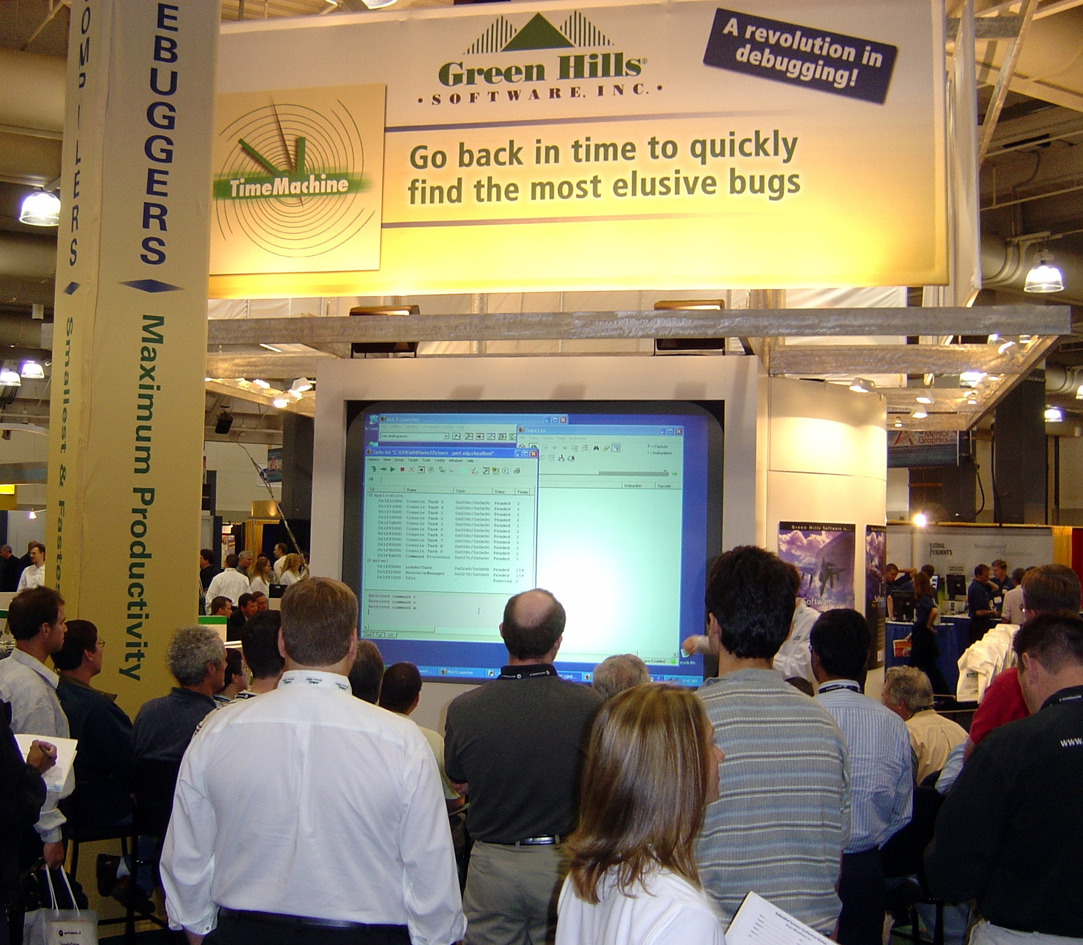 Conference attendees watch Green Hills product demonstrations